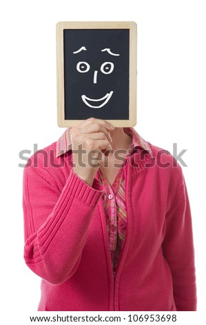 woman hiding her face behind a slate