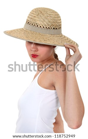 Woman hiding her face under a wide-brimmed hat