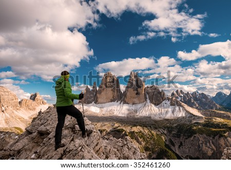 Woman hiker on a top of a mountain, Dolomites, Italy - stock photo
