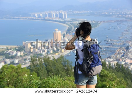 woman hiker taking photo outdoor  - stock photo