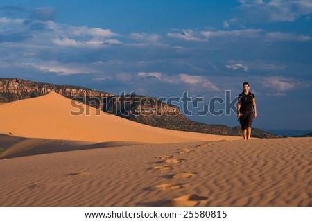 Woman hiking Coral Pink Sand Dunes, Utah - stock photo