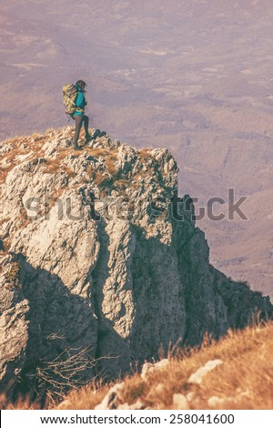 Woman hiking in beautiful mountain, recreation and healthy lifestyle outdoors in nature. Hiker backpacker looking at view. - stock photo