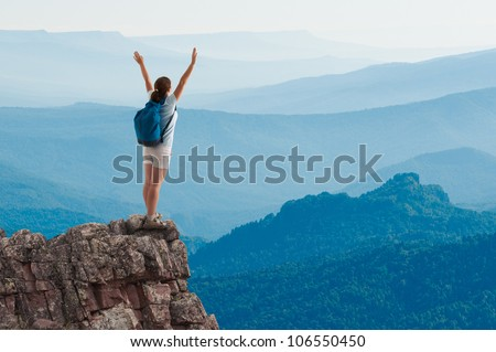 woman hiking in mountains - stock photo