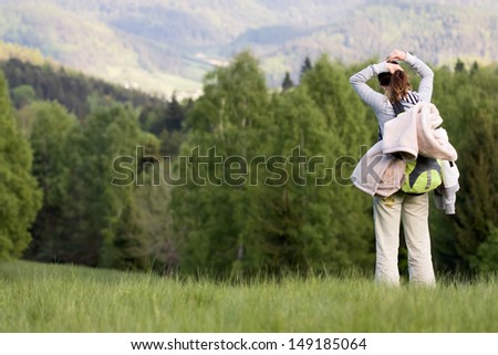 Woman hiking in the mountains - stock photo