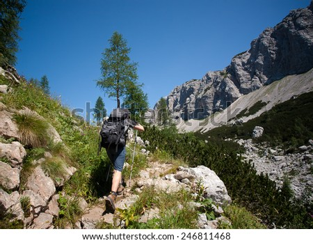 woman hiking on a sunny summer day in alps, slovenia - stock photo