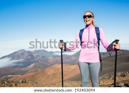 Woman hiking on beautiful mountain trail. Trekking and backpacking in the mountains. Healthy lifestyle outdoor adventure concept. - stock photo