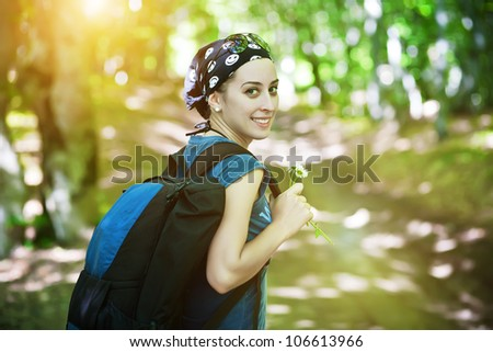 Woman hiking portrait . Fresh and healthy female model during hike outdoors in forest.