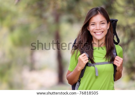 Woman hiking portrait with copy space. Fresh and healthy female model during hike outdoors in forest. Beautiful mixed race Caucasian / Chinese Asian young woman. Teide, Tenerife, Canary Islands, Spain - stock photo