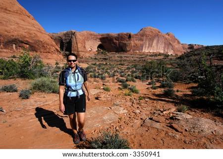 Woman hiking the Utah desert - stock photo