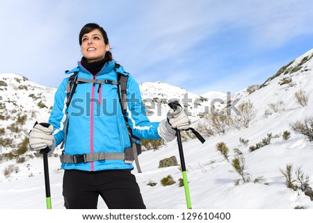 Woman hiking trip on winter mountain. Beautiful sporty hiker caucasian traveler. - stock photo