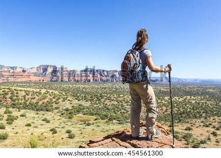 Woman hiking views landscape - stock photo