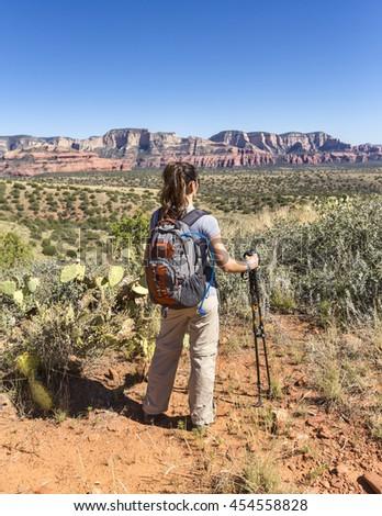 Woman hiking views path ahead - stock photo