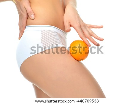 Woman hips legs buttocks and orange in hand cellulite weight loss control concept isolated against white background - stock photo