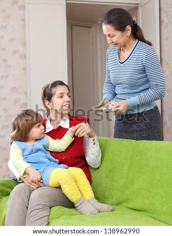 Woman hires governess for her child at home - stock photo