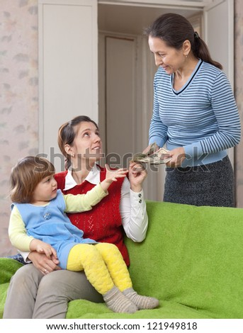 Woman hires nanny for her child at home - stock photo
