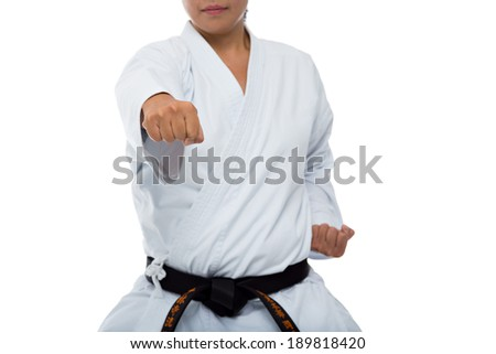 Woman hitting with her right fist - stock photo
