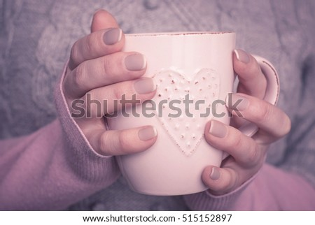 Woman hold a cup of hot tea. Winter drink.