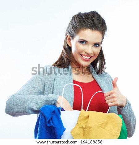 Woman hold bag with clothes. Young smiling model with long hair. Isolated white background. - stock photo