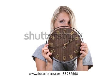 woman hold clock in front
