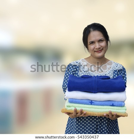 Woman hold clothes pile
