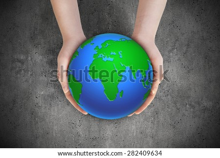 Woman hold globe on her hands. Earth planet in female hands - stock photo