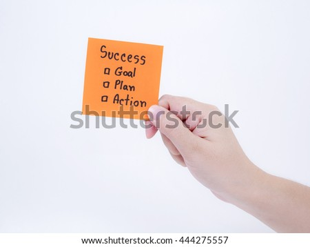Woman hold handwriting Success, Goal, Plan, Action on notepad in right hand on isolated / white background