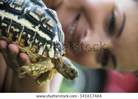 Woman hold in hand a turtle. - stock photo