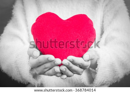 Woman hold Love symbol red heart , people, relationship and love concept