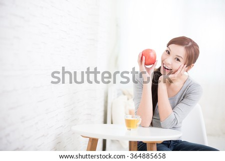 woman hold red apple at home, healthy lifestyle concept, asian beauty