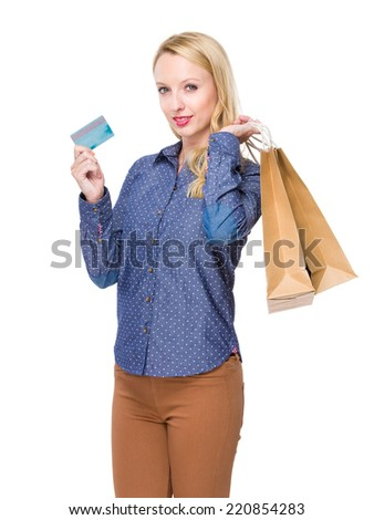 Woman hold shopping bag and credit card