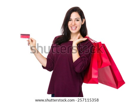 Woman hold shopping bag and credit card - stock photo