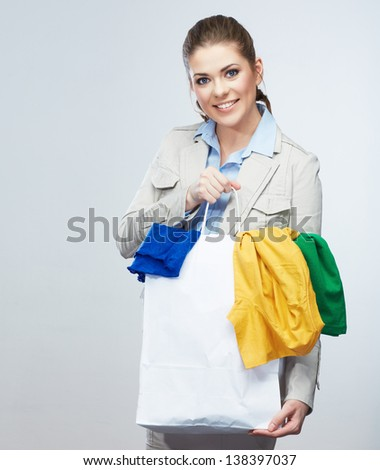 Woman hold shopping bag with clothes. Female studio portrait.