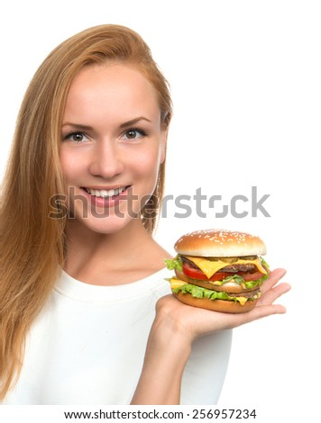 Woman hold tasty unhealthy burger sandwich with cheese salad tomatoes slice and beef in hands hungry getting ready to eat isolated on a white background Fast food concept
