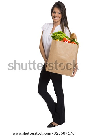 woman hold vegetables and fruits in grocery bag . food shopping . white background .