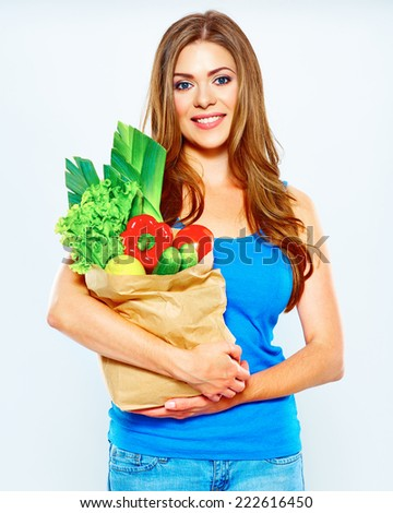 woman hold vegetables in grocery bag . food shopping . white background . - stock photo