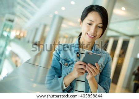 Woman hold with cellphone - stock photo