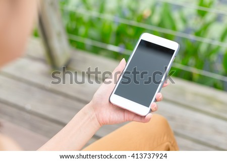 Woman hold with phone - stock photo