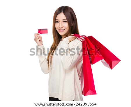 Woman hold with red shopping bag and credit card - stock photo