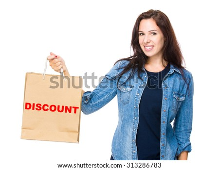 Woman hold with shopping bag for showing a word discount