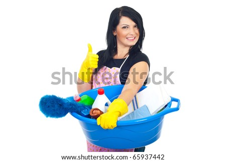 Woman holding a basin with brush and cleaning products and giving thumbs up with hands in gloves