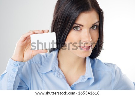 woman holding a blank card - stock photo