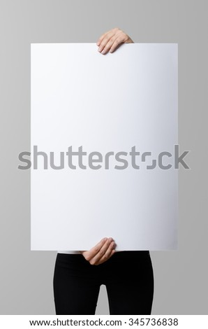 Woman holding a blank poster, 50x70, mockup. - stock photo