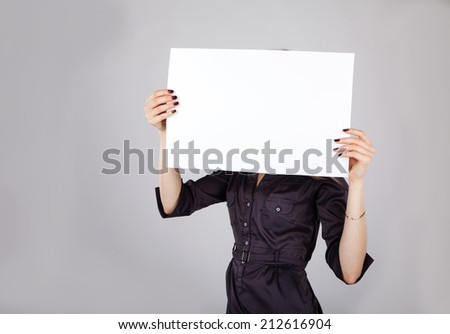 woman holding a blank sheet of paper
