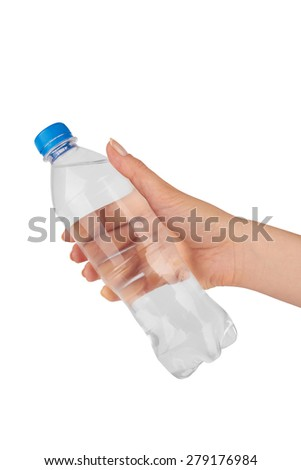Woman holding a bottle of water isolated on white background - stock photo