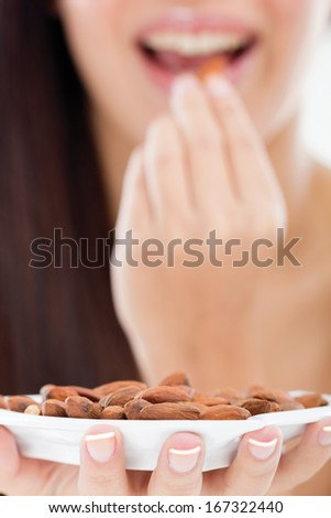 woman holding a bowl of almonds
