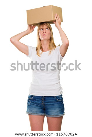 woman holding a box on her head against a white background - stock photo
