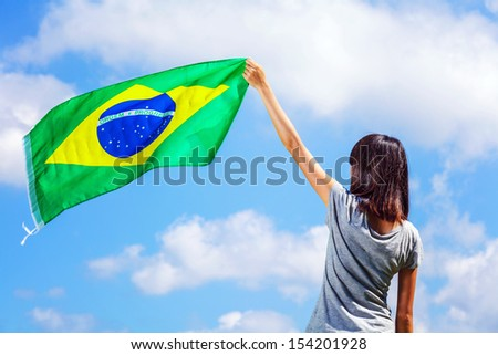 Woman holding a brazil flag - stock photo