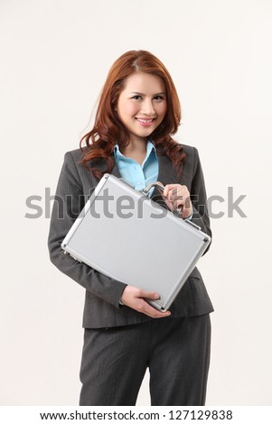 woman holding a brief case - stock photo
