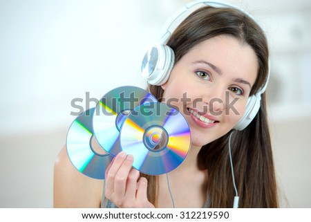 Woman holding a bunch of cds - stock photo