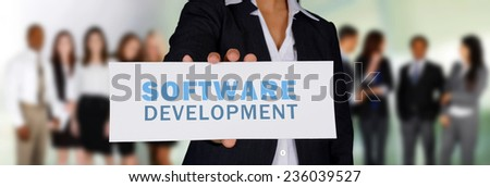 Woman holding a card for her web design firm